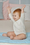 Child pulls hands up and smiles Royalty Free Stock Photo