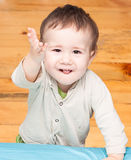 Child pulls his hand up Royalty Free Stock Photography