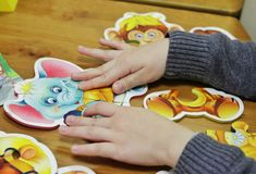 A child pulls puzzles royalty free stock images