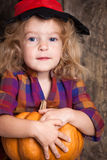 Child with pumpkin Stock Photography