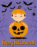 Child in a pumpkin costume and bats. Stock Photo