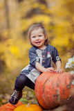 A child with a pumpkin Royalty Free Stock Images
