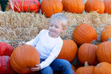 Child at pumpkin patch Royalty Free Stock Photos