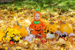 Child in pumpkin suit Stock Photos