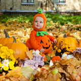 Child in pumpkin suit Stock Images