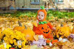 Child in pumpkin suit Royalty Free Stock Image