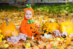 Child in pumpkin suit Royalty Free Stock Images