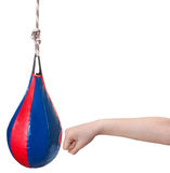 Child punches punching bag isolated Royalty Free Stock Photos