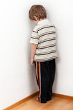 Child punishment. Little child boy wall corner punishment standing Royalty Free Stock Image