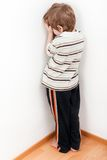 Child punishment. Little child boy wall corner punishment standing Royalty Free Stock Images