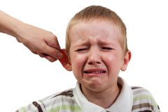 Child punishment. Violence and abuse - cry child pull ear punishment Royalty Free Stock Photos