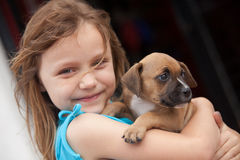 Child with pup Royalty Free Stock Image