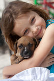 Child with pup Royalty Free Stock Photography