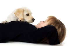 Child with puppy. Child with Labrador retriever puppy stock photography
