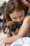 Child with puppy dog Stock Images