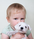 Child and puppy dog Stock Images