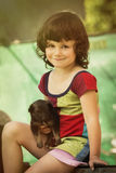 Child with puppy Royalty Free Stock Images