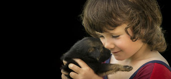 Child with puppy Stock Image
