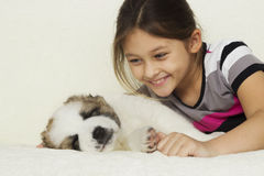Child and puppy Stock Photos
