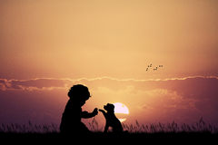 Child with puppy. Illustration of child with puppy at sunset Stock Images