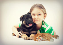 Child and puppy and kitten Royalty Free Stock Photography