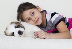 Child and puppy Stock Images