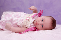 Child purple background. Close up of three year old child with a purple background stock photography