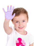 A child with purple paint on her hand Stock Photo