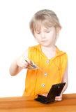 A child with a purse and dollar bills Royalty Free Stock Photos