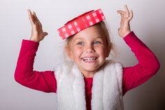 Child put a box on his head Stock Photography
