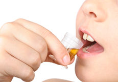 The child puts the pill into his mouth royalty free stock photo