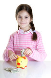 Child putting dollars in money box Royalty Free Stock Photography