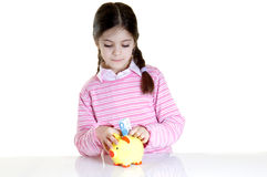 Child putting eur in money box Stock Photo