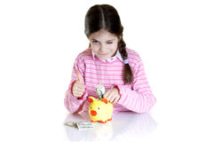 Child putting Eur  in money box Stock Photography