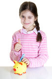 Child putting Eur  in money box Royalty Free Stock Photos