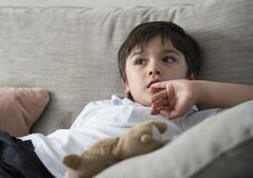 Free Child Putting Finger In His Mouth. Schoolboy Biting His Finger Nails While Watching TV, Emotional Kid Portrait, Young Boy Siting Royalty Free Stock Photography - 196891467