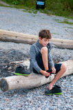 Child putting on his shoes Royalty Free Stock Photo