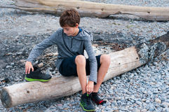 Child putting on his shoes Royalty Free Stock Photography
