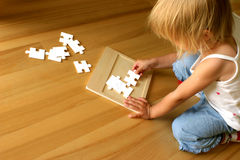 Child and  puzzle Royalty Free Stock Photo