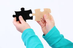 Child with puzzle Stock Images
