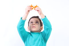 Child with puzzle Stock Image