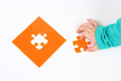 Child with puzzle Royalty Free Stock Photo