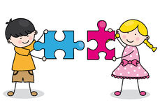 Child with puzzle pieces. Parts which are connected to each Royalty Free Stock Photo