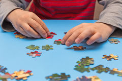 Child and puzzles Stock Images