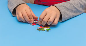 Child and puzzles Royalty Free Stock Photo
