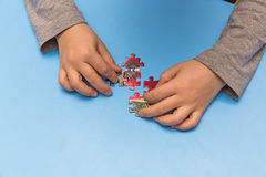 Child and puzzles Royalty Free Stock Photography