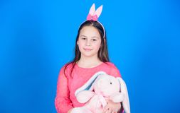 Child in rabbit bunny ears. Egg hunt. Family holiday. Little girl with hare toy. Spring party. Happy easter. Happy. Moments. Enjoying every moment. Great royalty free stock images