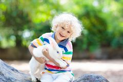 Child with rabbit. Easter bunny. Kids and pets. Royalty Free Stock Photography