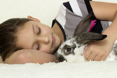 Child and rabbit Stock Photography