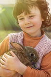 Child with rabbit Stock Images